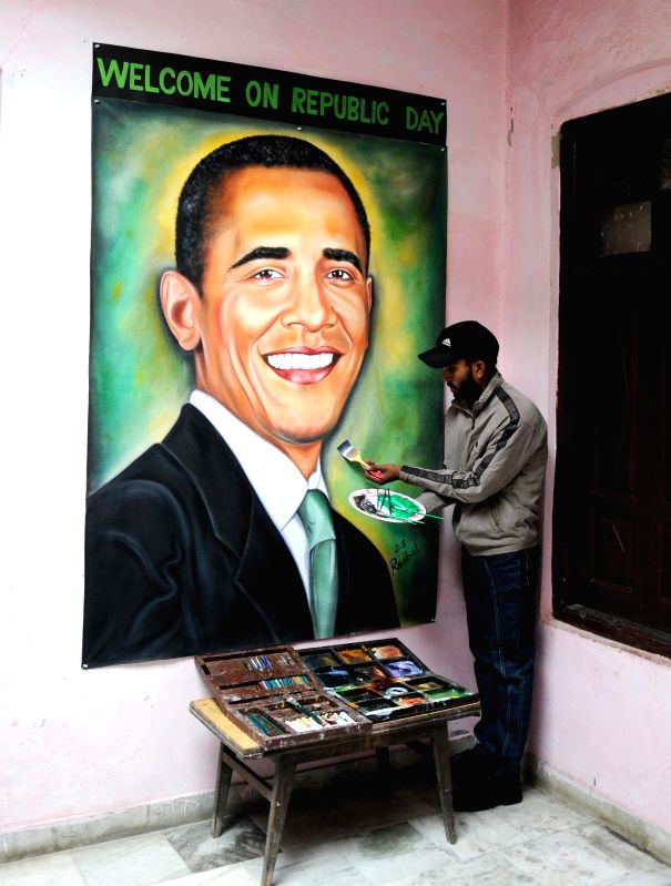 Artist Jagjot Singh Rubal welcomes US President Barack Obama, who is going to visit India this Republic Day, by painting his portrait in Amritsar on Jan 21, 2015.