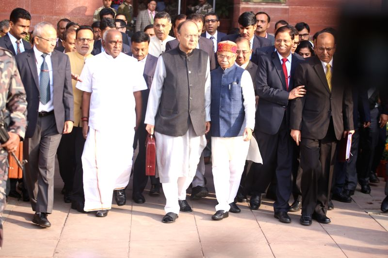 : New Delhi: Arun Jaitley, Union Minister of Finance with Pratap Shukla, MOS (Finance), Pon. Radhakrishnan, MOS (Finance), Dr. Hasmukh Adhia, Finance Secretary and other officials  at Finance ...