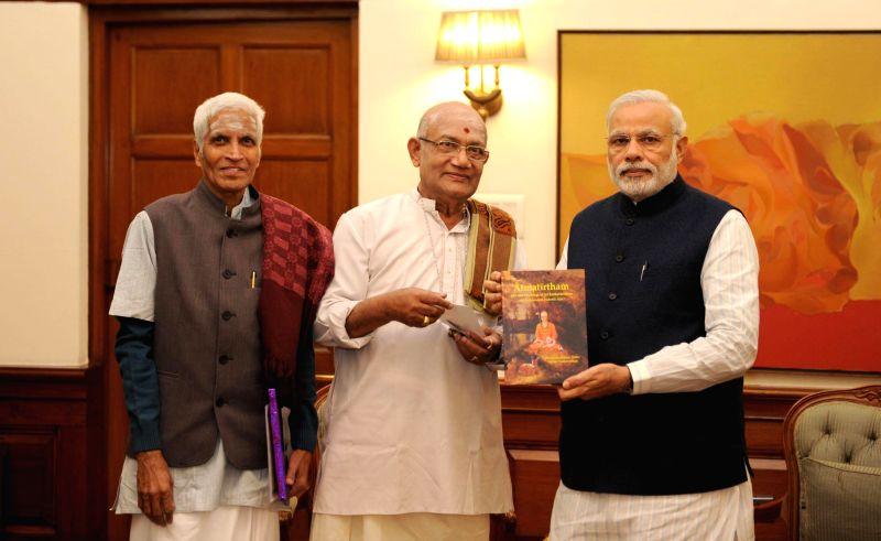 `Atmatirtham` - a book on Adi Sankara's life and teachings being presented to the Prime Minister Narendra Modi, in New Delhi on Feb 13, 2015. - Narendra Modi