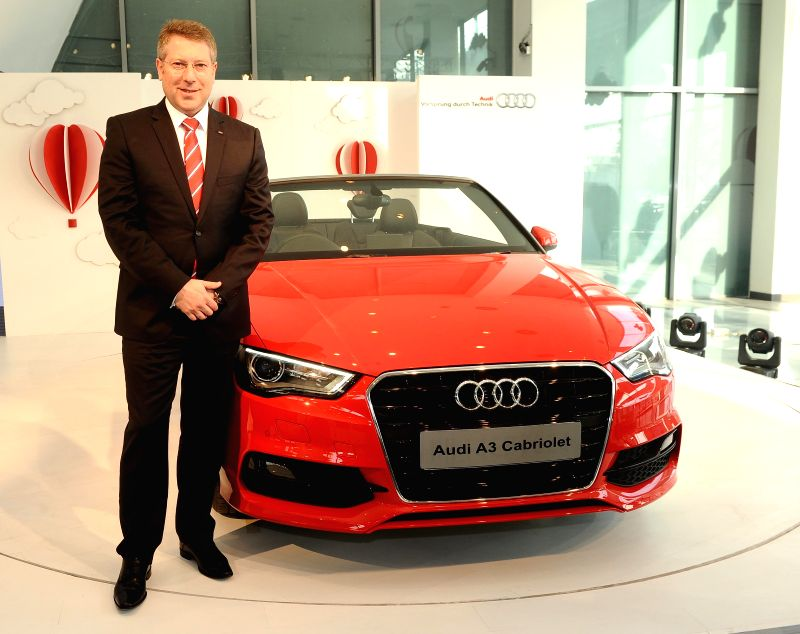 Audi India Head Joe King with the newly launched Audi A3 Cabriolet in New Delhi, on Dec 11, 2014.