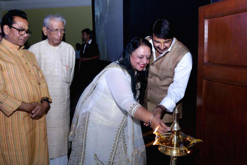 Author Ashok Chakradhar, author Rama Pandey and actor-turned politician Manoj Tiwari during the launch of author Rama Pandey`s books Guhaar, Giraftaar and a documentary `Kalam Se Camera ... - Pandey