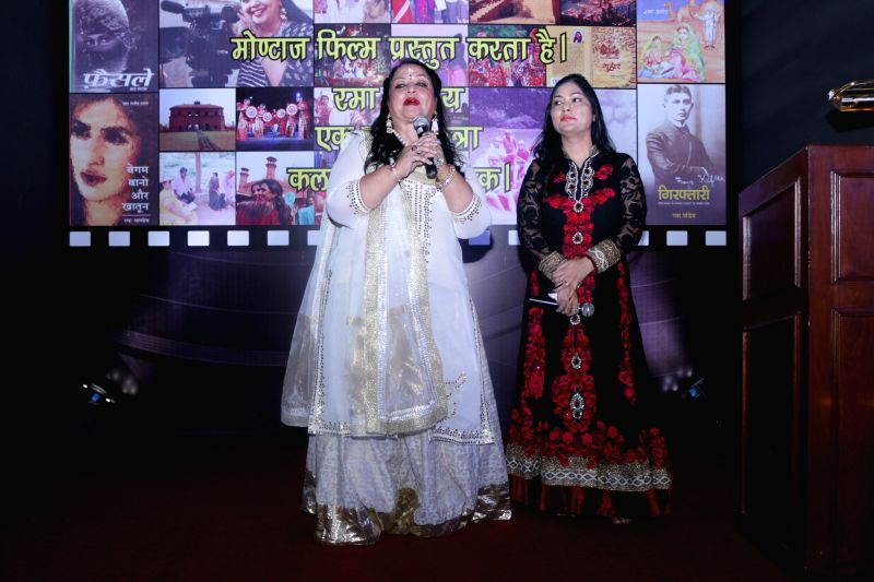 Author Rama Pandey addresses during the launch of her books `Guhaar`, Giraftaar and a documentary `Kalam Se Camera Tak` in New Delhi, on April 3, 2015. - Rama Pandey
