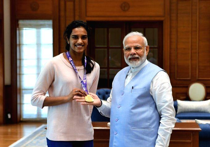 New Delhi: Badminton world champion PV Sindhu calls on Prime Minister Narendra Modi in New Delhi, on Aug 27, 2019. (Photo: IANS)