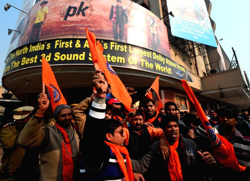 Bajrang Dal workers stage a demonstration outside a Delhi theatre screening Aamir Khan starrer  `PK`, on Dec 30, 2014. - Aamir Khan