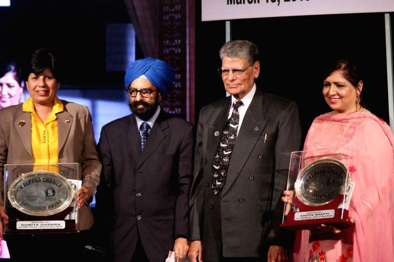 New Delhi:Banarasi Lal Chawla, the father of famous Indian astronaut Kalpana Chawla with Jaspal Bhatti's widow Savita Bhatti and former Indian marathon runner Sunita Godara during a programme ...