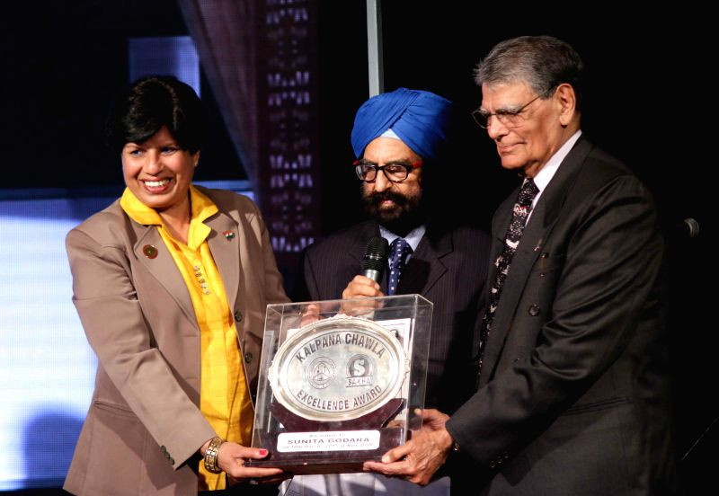 New Delhi:Banarasi Lal Chawla, the father of famous Indian astronaut Kalpana Chawla confers Kalpan Chawal Excellence Award 2015 to former Indian marathon runner Sunita Godara during a programme at ...