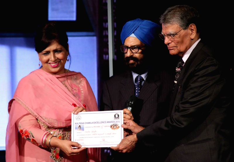 New Delhi:Banarasi Lal Chawla, the father of famous Indian astronaut Kalpana Chawla confers Kalpan Chawal Excellence Award 2015 to Jaspal Bhatti's widow Savita Bhatti during a programme at the India ...