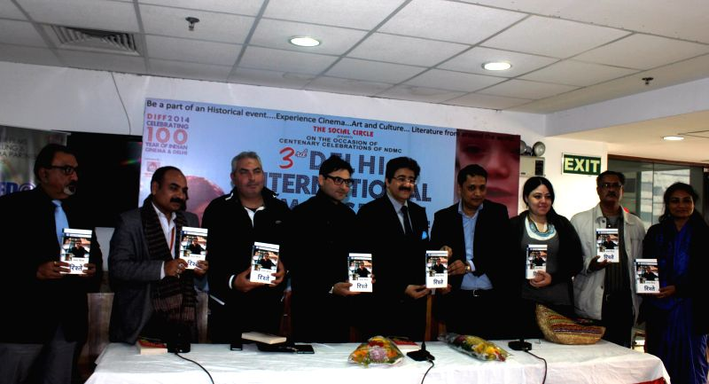Bangladeshi filmmaker Mohammed Khaled Hossain and others at the launch of Sanjay Sinha's book `Rishtey` at NDMC Convention Centre in New Delhi on Dec 24, 2014. - Sanjay Sinha