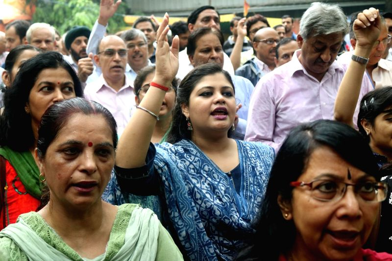 New Delhi : Bank employees affiliated to United Forum of Bank Unions (UFBU) stage a demonstration to protest against central government's policies for the banking sector, in New Delhi on July 29, ...