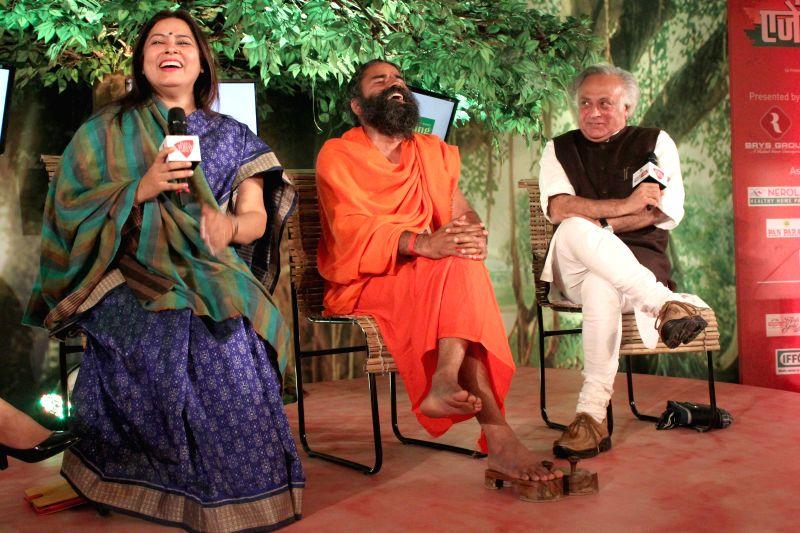 Bharatiya Janata Party (BJP) MP Meenakshi Lekhi, Yoga guru Baba Ramdev and Congress MP Jairam Ramesh during a programme organised by Aaj Tak news channel in New Delhi, on Dec 13, 2014.