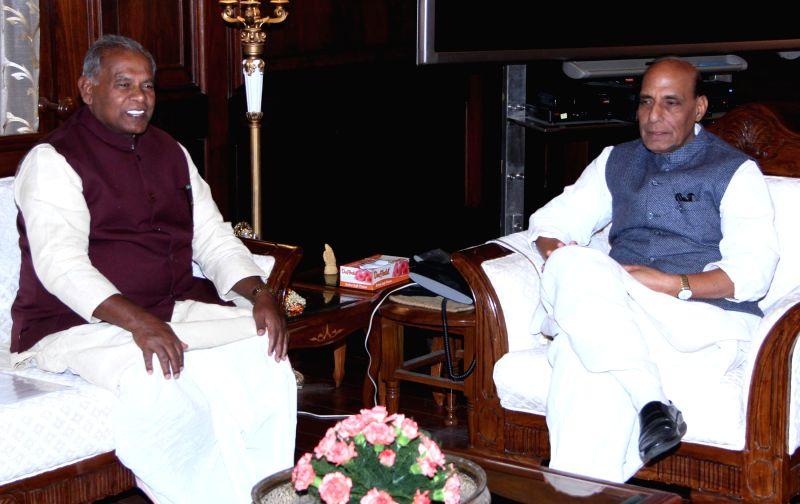 Bihar Chief Minister Jitan Ram Manjhi calls on the Union Home Minister Rajnath Singh, in New Delhi on Dec 8, 2014.