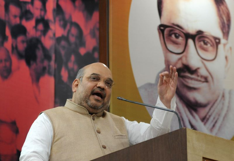 BJP chief Amit Shah addresses at party's Maha Sampark Abhiyaan at party headquarters in New Delhi on April 20, 2015.