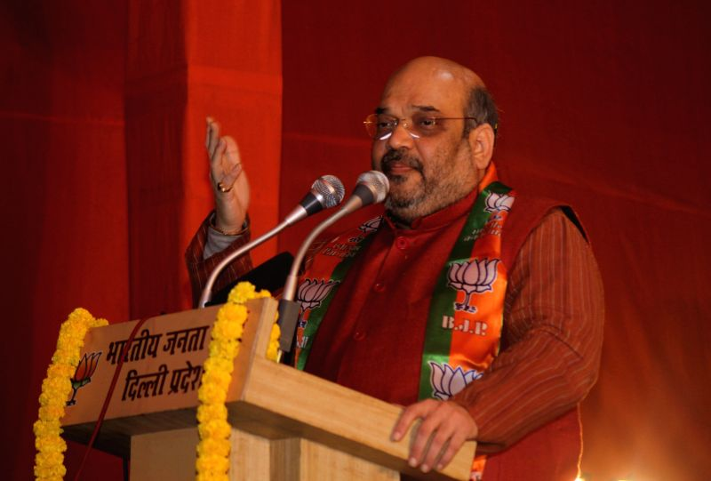BJP chief Amit Shah addresses during a party programme in New Delhi, on Dec 30, 2014.