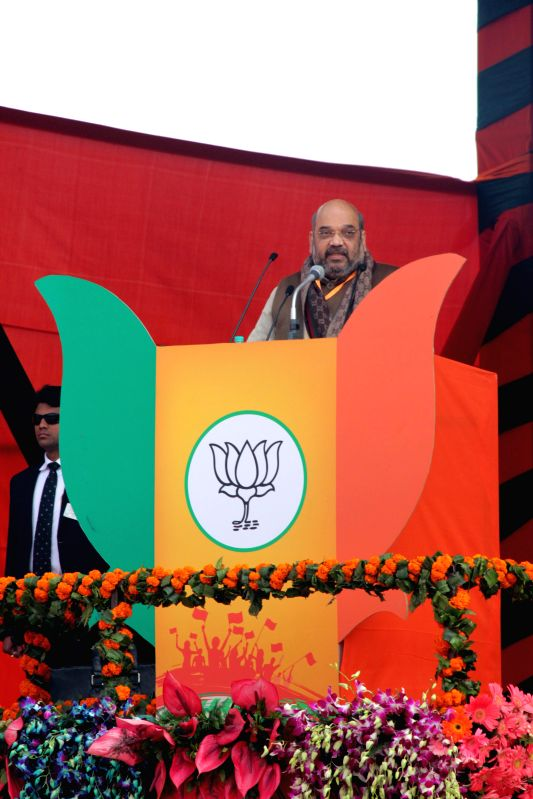 BJP chief Amit Shah addresses during a rally to celebrate party's success in the recently concluded assembly polls in Jharkhand and Jammu and Kashmir at Ramlila Maidan in New Delhi on Jan . - Amit Shah