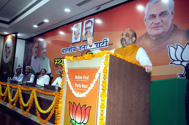 BJP chief Amit Shah addresses during a programme organised on the foundation day of the party in New Delhi on April 6, 2015. - Amit Shah