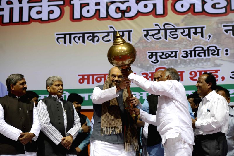 BJP chief Amit Shah being felicitated at the Valmiki Milan Utsav in New Delhi on Dec 1, 2014.