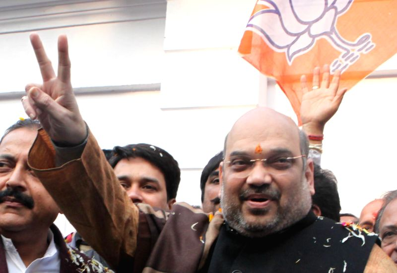 BJP chief Amit Shah celebrates party's performance in the recently held Jharkhand and Jammu and Kashmir polls at party office in New Delhi, on Dec 23, 2014.