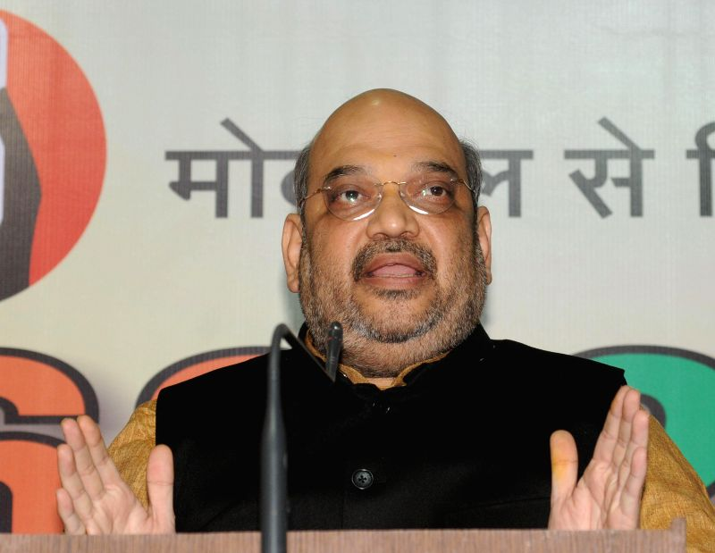 BJP chief Amit Shah during a press conference regarding party's performance in the recently held Jharkhand and Jammu and Kashmir polls at party office in New Delhi, on Dec 23, 2014.