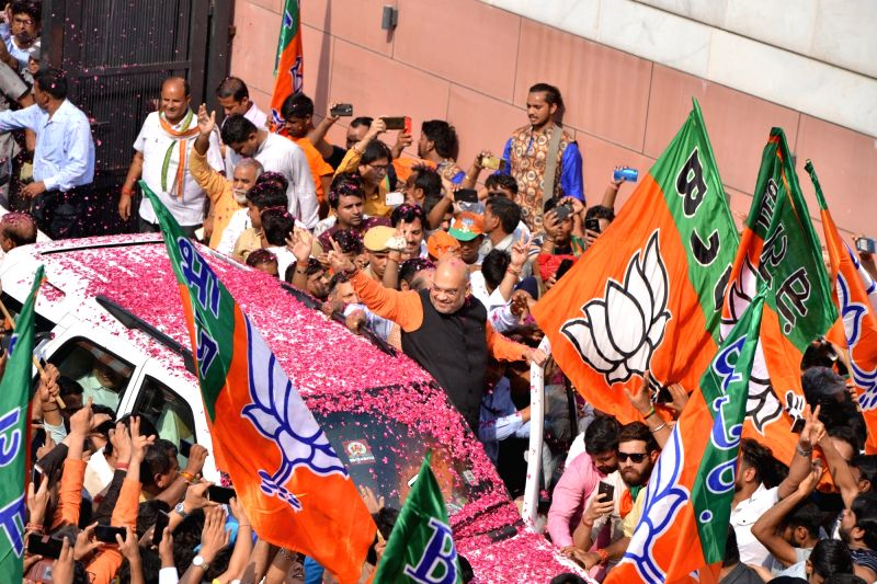 New Delhi: BJP chief Amit Shah joins victory celebrations at the party's headquarters after the BJP led by Prime Minister Narendra Modi is set to retain power for another five years after making a sweep of the Lok Sabha battle and mauling the opposit