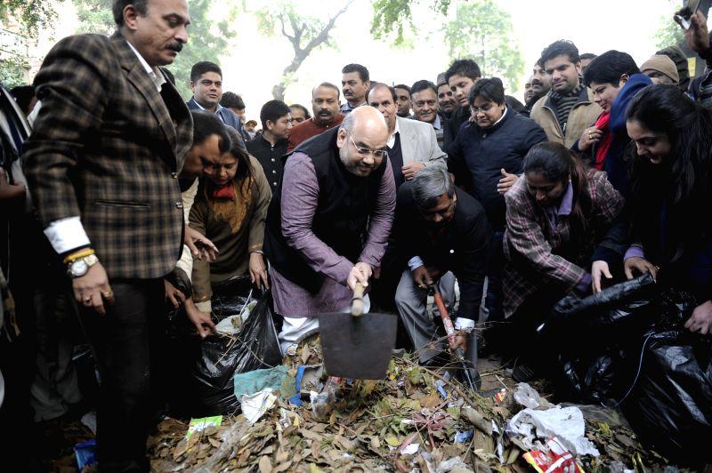 BJP chief Amit Shah participates in Clean India Campaign at Gol Market in New Delhi, on Dec 25, 2014.