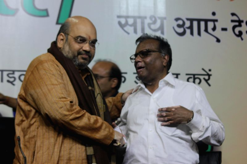 BJP Chief Amit Shah with General Secretary of National Federation of the Blind Santosh Kumar Rungta during a programme organised at BJP office on `International Day for Persons with ... - Amit Shah and Santosh Kumar Rungta