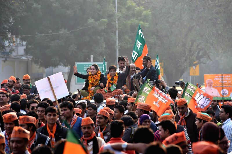 BJP Chief Ministerial candidate Kiran Bedi with party candidate from New Delhi Nupur Sharma during an election campaign in New Delhi on Feb. 2, 2015. - Delhi Nupur Sharma