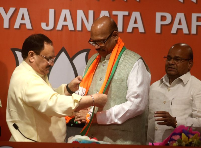 New Delhi: BJP leader J.P. Nadda and Thawar Chand Gehlot welcomes TDP MP T. G. Venkatesh into the party at the party's headquarters in New Delhi on June 20, 2019. (Photo: IANS)