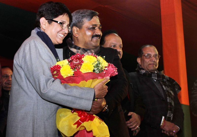 BJP leader Kiran Bedi, Delhi BJP chief Satish Upadhyay, and others during a programme organised to welcome new entrants into the party in New Delhi, on Jan 16, 2015. - Kiran Bedi and Satish Upadhyay