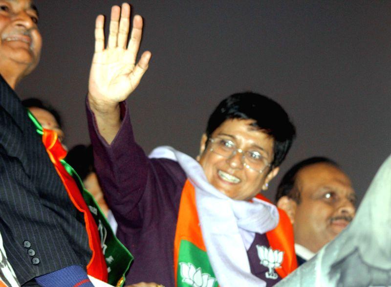 BJP leader Kiran Bedi participates in a party roadshow in Rohini, New Delhi on Jan 19, 2015.