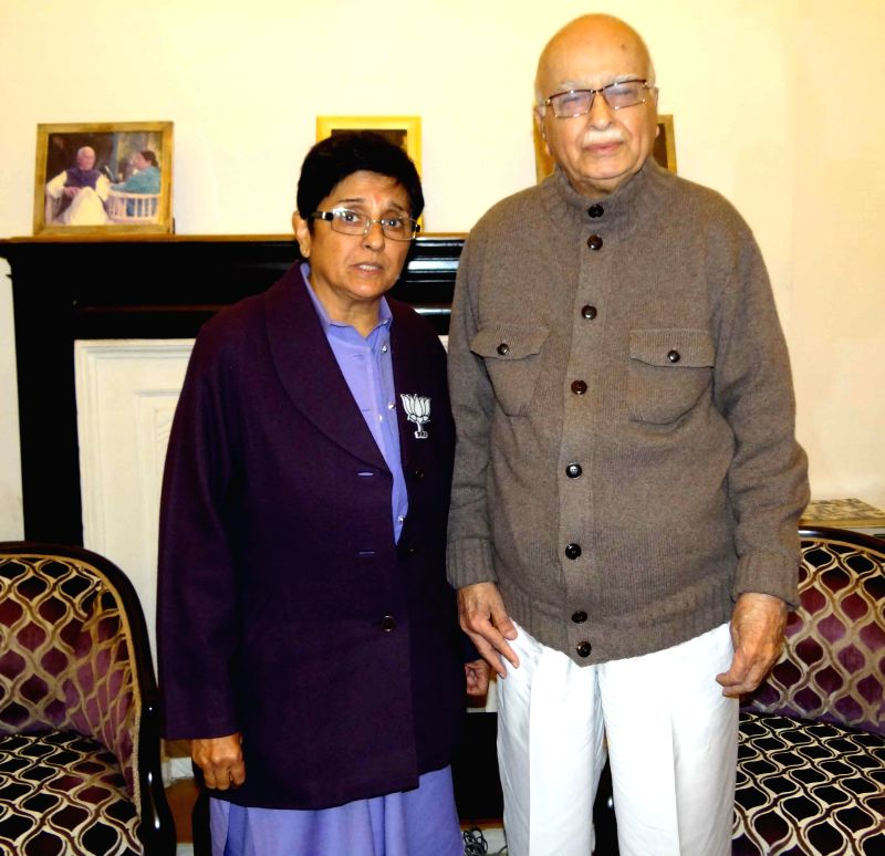 BJP leader Kiran Bedi takes blessings of party veteran and party MP from Gandhinagar L K Advani in New Delhi, on Jan 23, 2015.