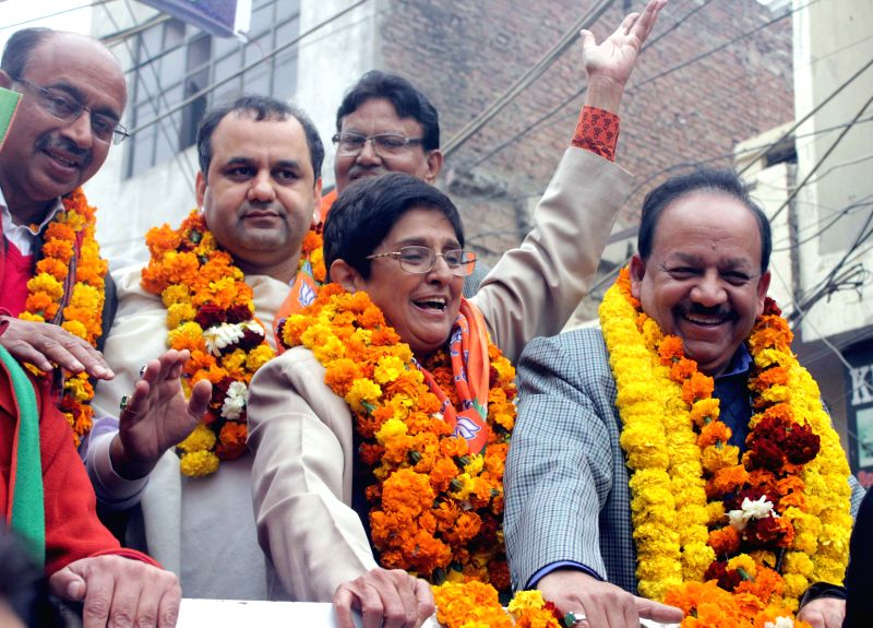 BJP leader Kiran Bedi  with party leader Vijay Goel, Union Minister for Science & Technology and Earth Sciences Dr. Harsh Vardhan and others proceeds to file her nomination papers for .