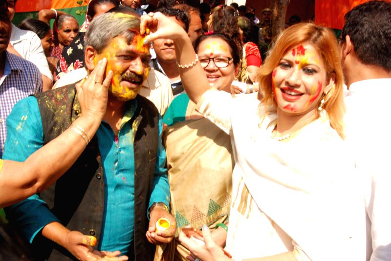 BJP leader Satish Upadhyay celebrates Holi during a Holi Milan programme organised at BJP office in New Delhi, on March 5, 2015. - Satish Upadhyay