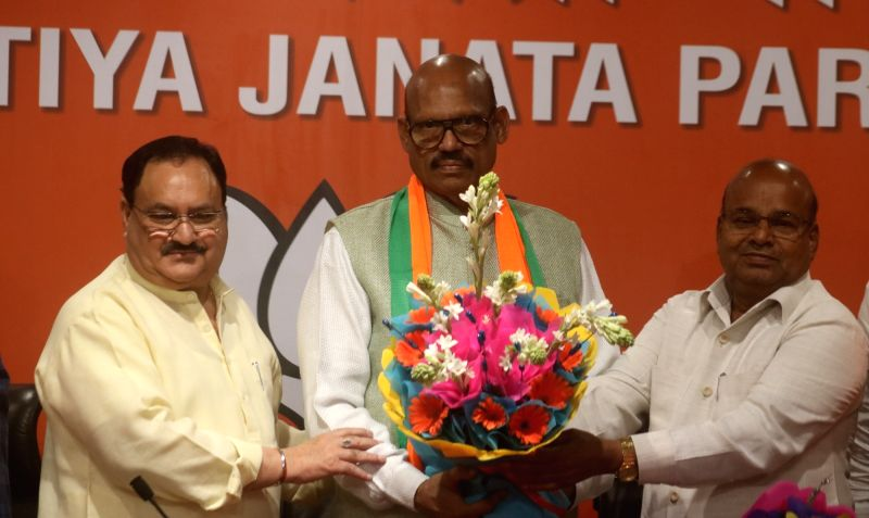 New Delhi: BJP leaders J.P. Nadda and Thawar Chand Gehlot welcome TDP MP T. G. Venkatesh into the party at the party's headquarters in New Delhi on June 20, 2019. (Photo: IANS)