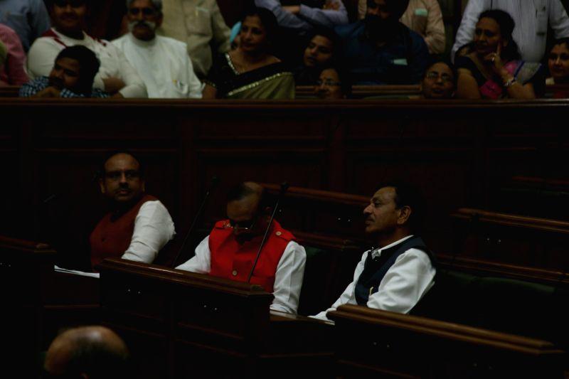 BJP legislators Vijender Gupta, Om Prakash Sharma and Jagdish Pradhan on the first day of Delhi Legislative Assembly's session after the formation of the new government, on Feb 23, 2015. - Vijender Gupta and Prakash Sharma