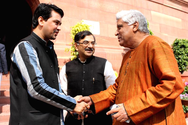 BJP MP Anurag Thakur and Rajya Sabha member and lyricist and scriptwriter Javed Akhtar  at the Parliament in New Delhi, on March 11, 2015.