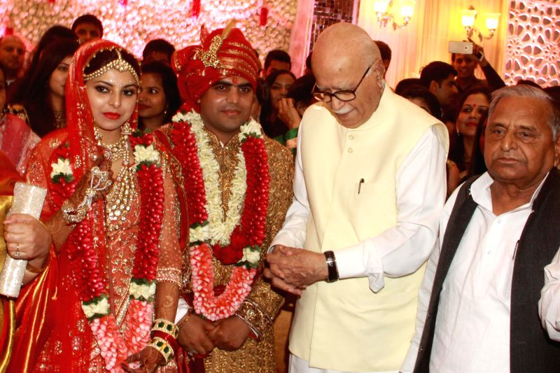 BJP MP from Gandhinagar L K Advani blesses RJD chief Lalu Yadav's daughter Raj Lakshmi and Samajwadi Party supremo Mulayam Singh Yadav's grandnephew and MP Tej Pratap Yadav during their ... - Lalu Yadav, Mulayam Singh Yadav and Tej Pratap Yadav