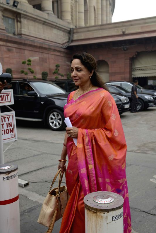 BJP MP from Mathura Hema Malini arrives at the Parliament to attend the second day of the budget session of the house in New Delhi, on Feb 24, 2015. - Hema Malini
