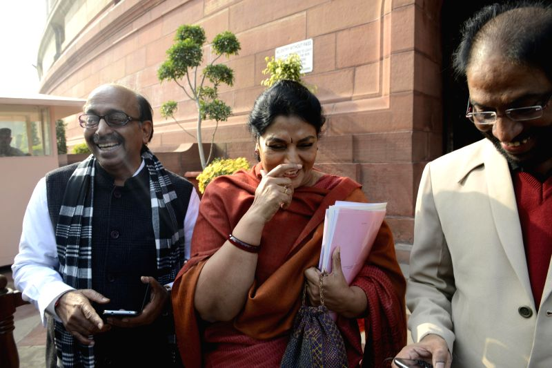 BJP MP Vijay Goel with Congress MP Renuka Chowdary at the Parliament premises in New Delhi, on Dec 18, 2014.