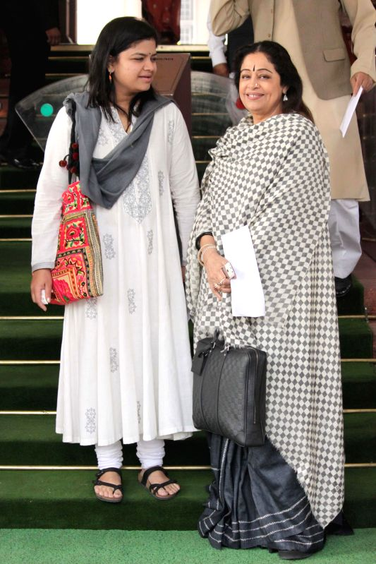 BJP MPs from Mumbai-North-Central and Chandigarh, Poonam Mahajan and Kiran Kher respectively, at the Parliament premises in New Delhi, on Nov 28, 2014. - Poonam Mahajan and Kiran Kher