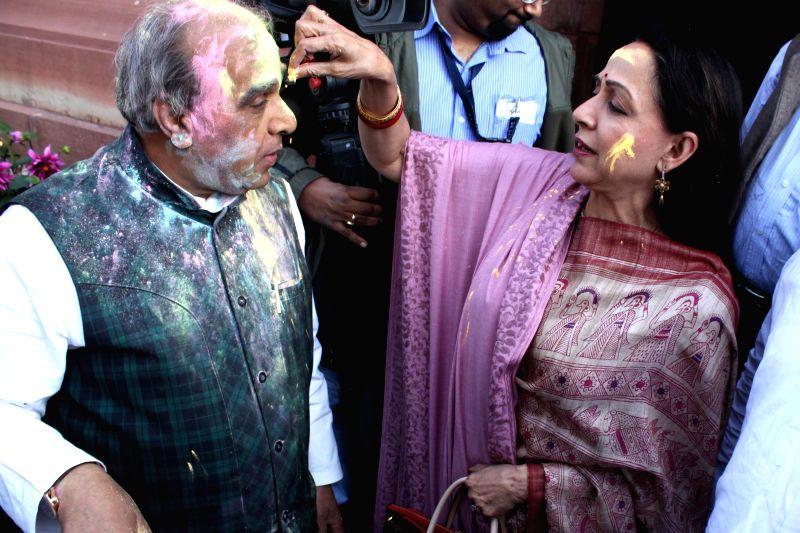 BJP MPs Jagdambika Pal and Hema Malini celebrate Holi at the Parliament in New Delhi, on March 4, 2015. - Hema Malini
