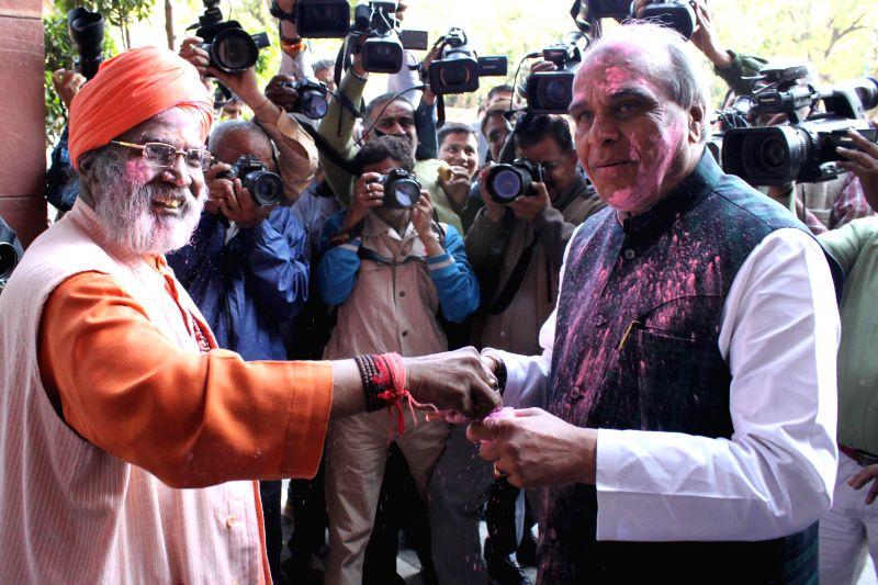 BJP MPs Jagdambika Pal and Sakshi Maharaj celebrate Holi at the Parliament in New Delhi, on March 4, 2015.