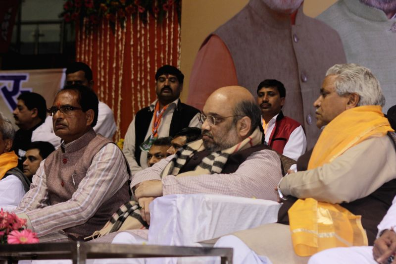 BJP president Amit Shah, Madhya Pradesh Chief Minister Shivraj Singh Chauhan, state party chief Satish Upadhyay, senior leader Prabhat Jha and others during a party rally at Talkatora ... - Shivraj Singh Chauhan and Satish Upadhyay