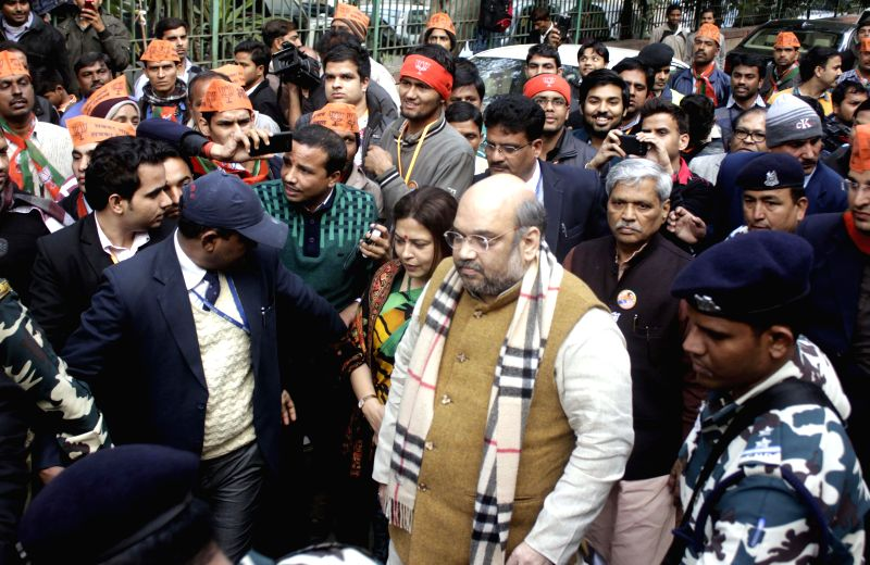 BJP president Amit Shah with party leaders Meenakshi Lekhi, Prabhat Jha and other during inauguration of a party office at Khan Market in New Delhi on Jan. 24, 2015.