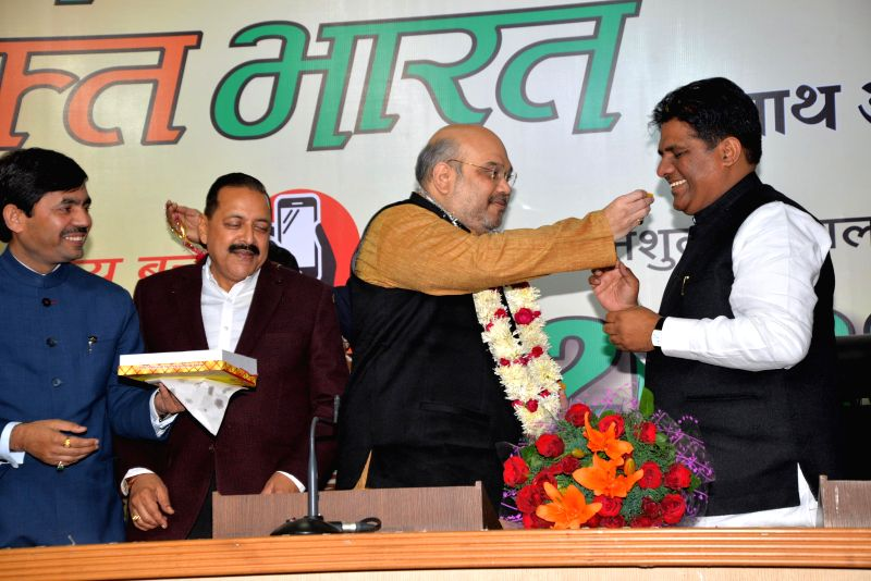 BJP spokesperson Syed Shahnawaz Hussain, BJP chief Amit Shah, Union Minister of State in the Prime Minister's Office and BJP leader Jitendra Singh during a press conference regarding ... - Jitendra Singh