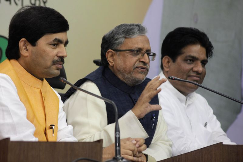 BJP spokesperson Syed Shahnawaz Hussain with BJP leaders Sushil Kumar Modi and Bhupendra Yadav during a press conference at the BJP party office, in New Delhi on Feb 16, 2015. - Sushil Kumar Modi and Bhupendra Yadav