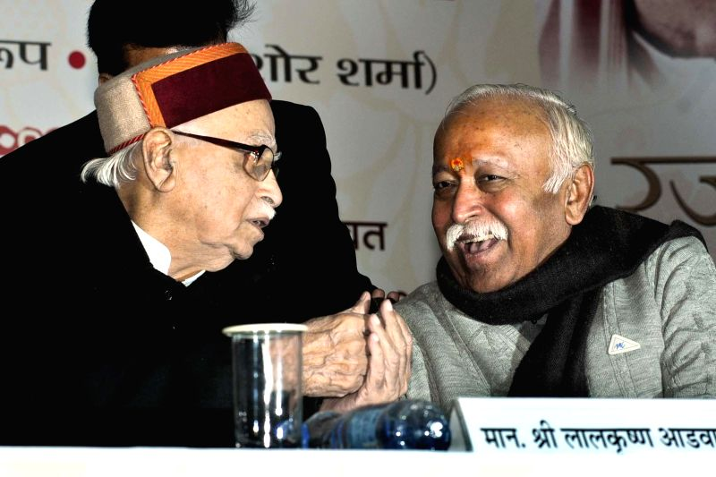 BJP veteran and party MP from Gandhinagar L K Advani and RSS chief Mohan Bhagwat at a programme organised to launch `Humare Rajju Bhaiya` - a book, in New Delhi on Dec 24, 2014.