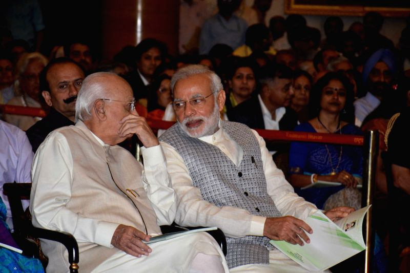 BJP veteran L K Advani with Prime Minister Narendra Modi during a Civil Investiture Ceremony organised to present Padma Awards at the Rashtrapati Bhavan in New Delhi on April 8, 2015. - Narendra Modi and L K Advani