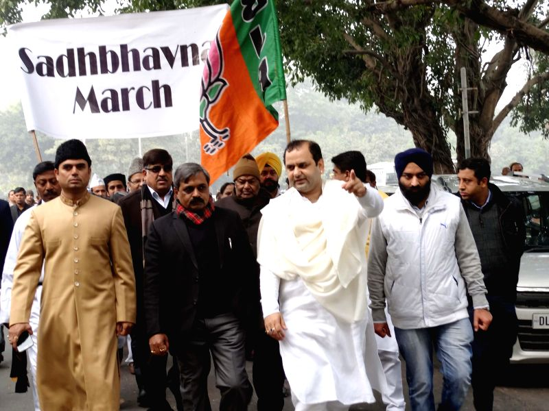 BJP workers led by Delhi BJP chief Satish Upadhyay participate in Sadbhawna March at Raj Ghat in New Delhi on Jan 9, 2015. - Satish Upadhyay