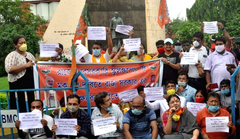 New Delhi: BJP workers led by party leader Locket Chatterjee stage a demonstration to protest against a hike in school fee and charging of fee from parents in the COVID-19 lockdown period by private schools, near Bikash Bhavan in Kolkata on June 15,