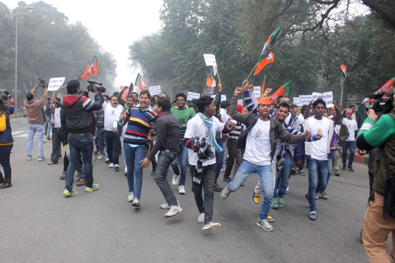BJP workers participate in Jhuggi Jhopdi Andolan in New Delhi, on Jan 8, 2015.